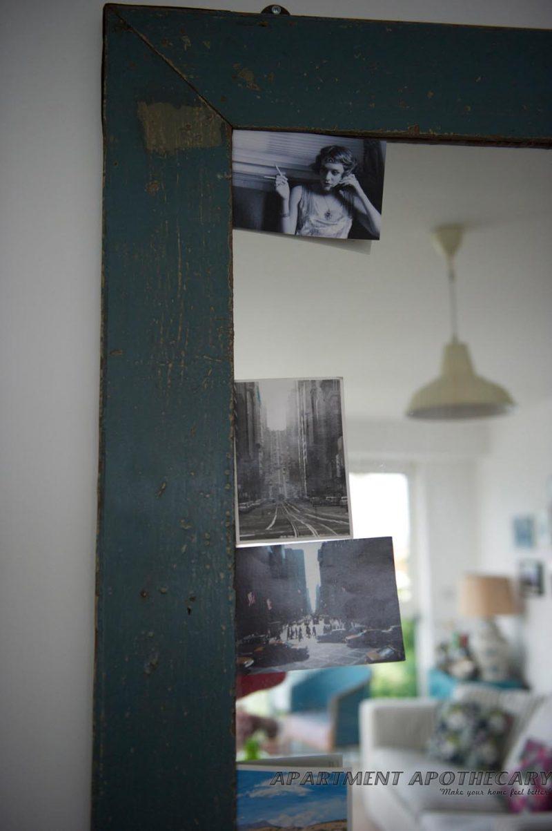 Postcards on mirror