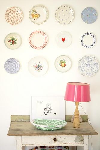Display of hanging plates on wall.