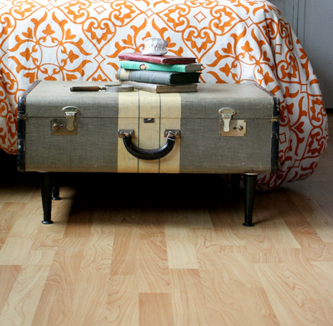 Vintage suitcase with legs.