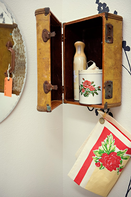 Vintage suitcase upcycled into a bathroom cabinet.