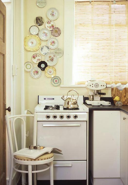 A display of plates on a kitchen wall.