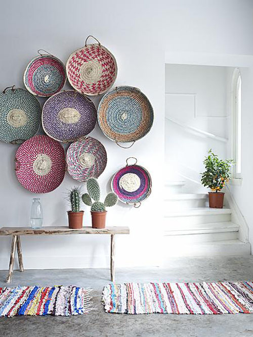 Woven straw baskets hanging on wall
