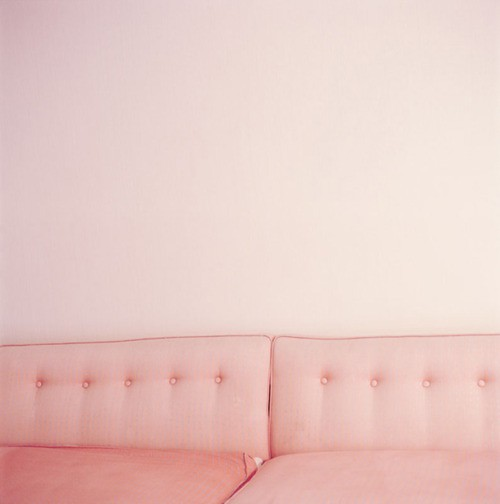 Pink wall and pink sofa