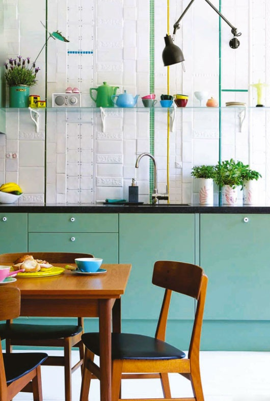 How to combine styles like this modern kitchen with fifties dining table