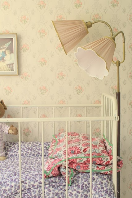 Vintage lamp and fabrics in nursery