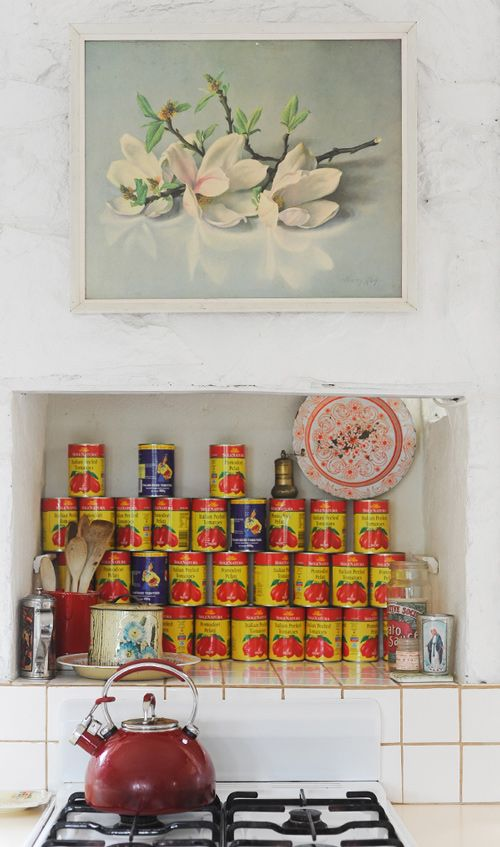 Cans of tomatoes as kitchen decoration