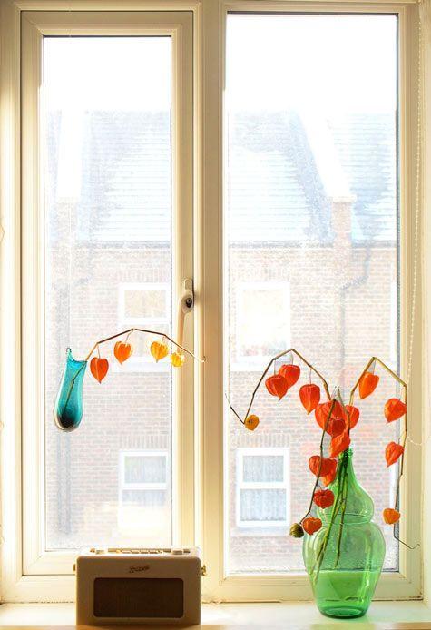 Hand blown glass vase and Roberts radio on window sill