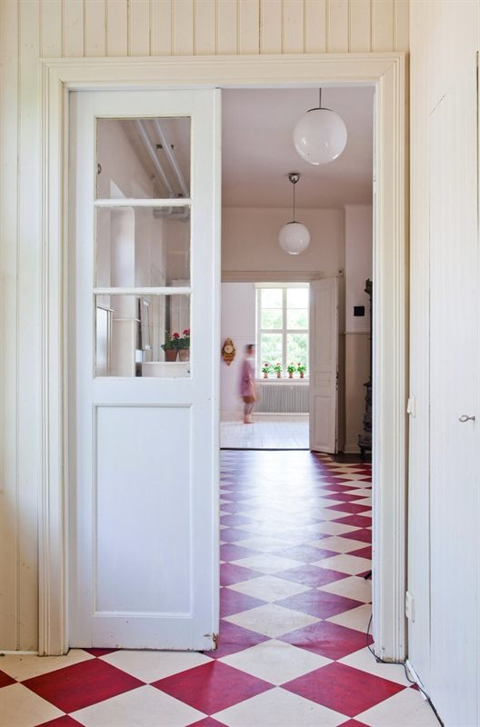 How to choose the right floor: Red and white vinyl floor www.apartmentapothecary.com