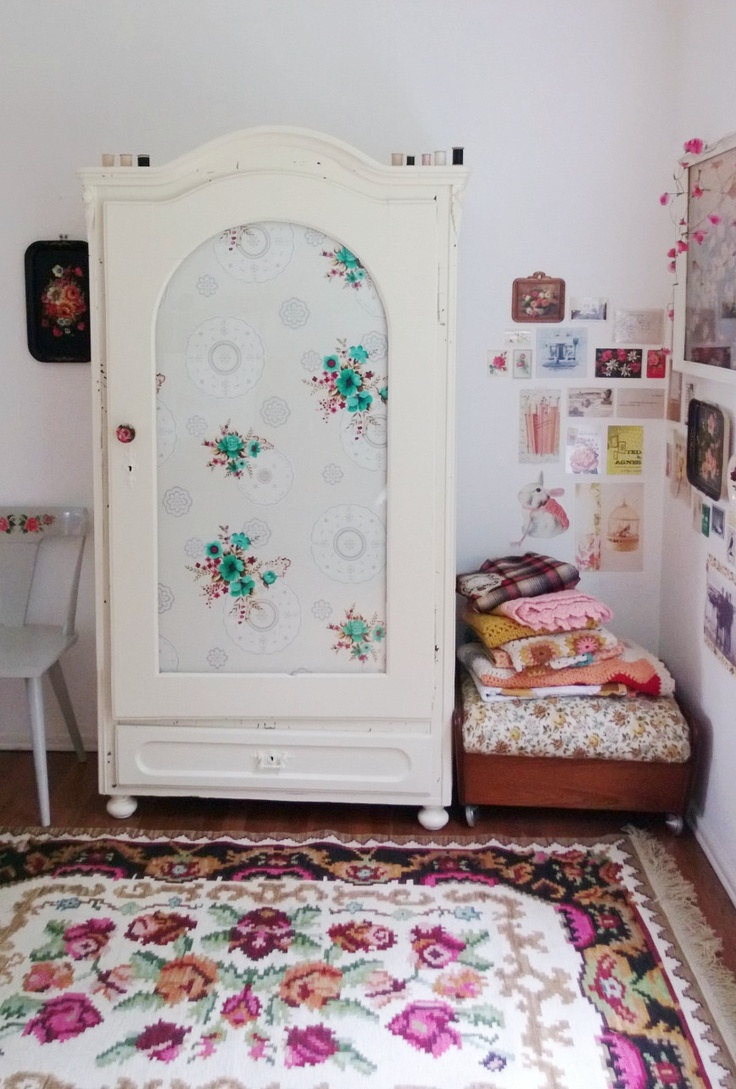 Fabric panelled cupboard doors by www.apartmentapothecary.com