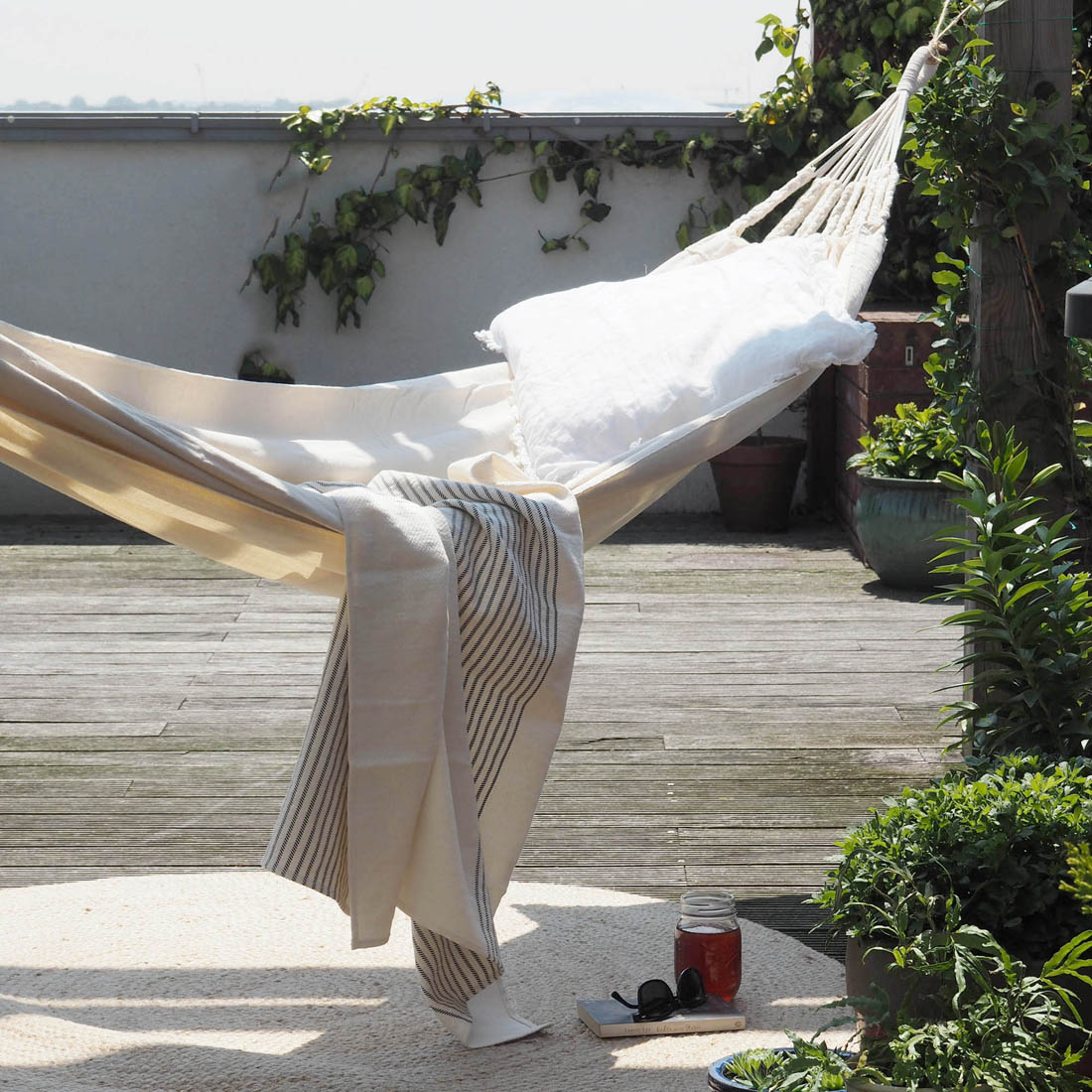 Summer living with Urbanara   Hammock on roof terrace   Apartment Apothecary