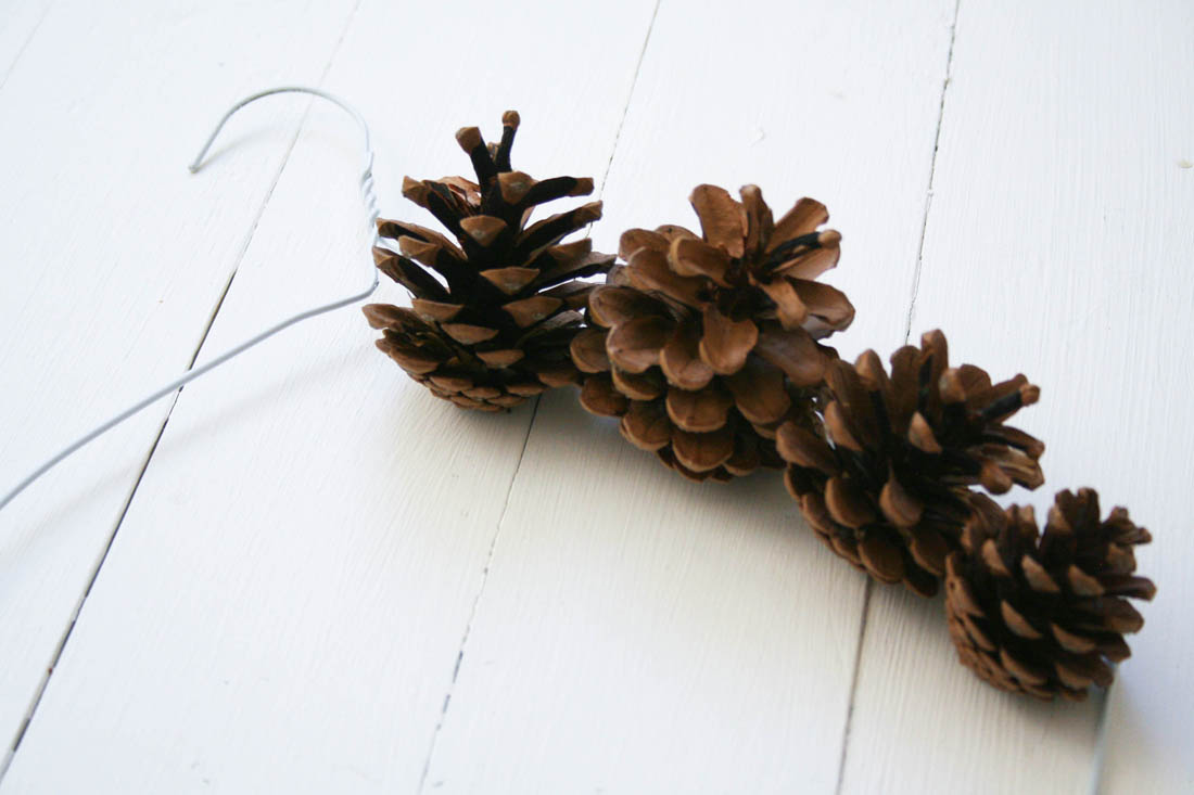 DIY pine cone wreath   Neon pink Christmas decorations   Apartment Apothecary