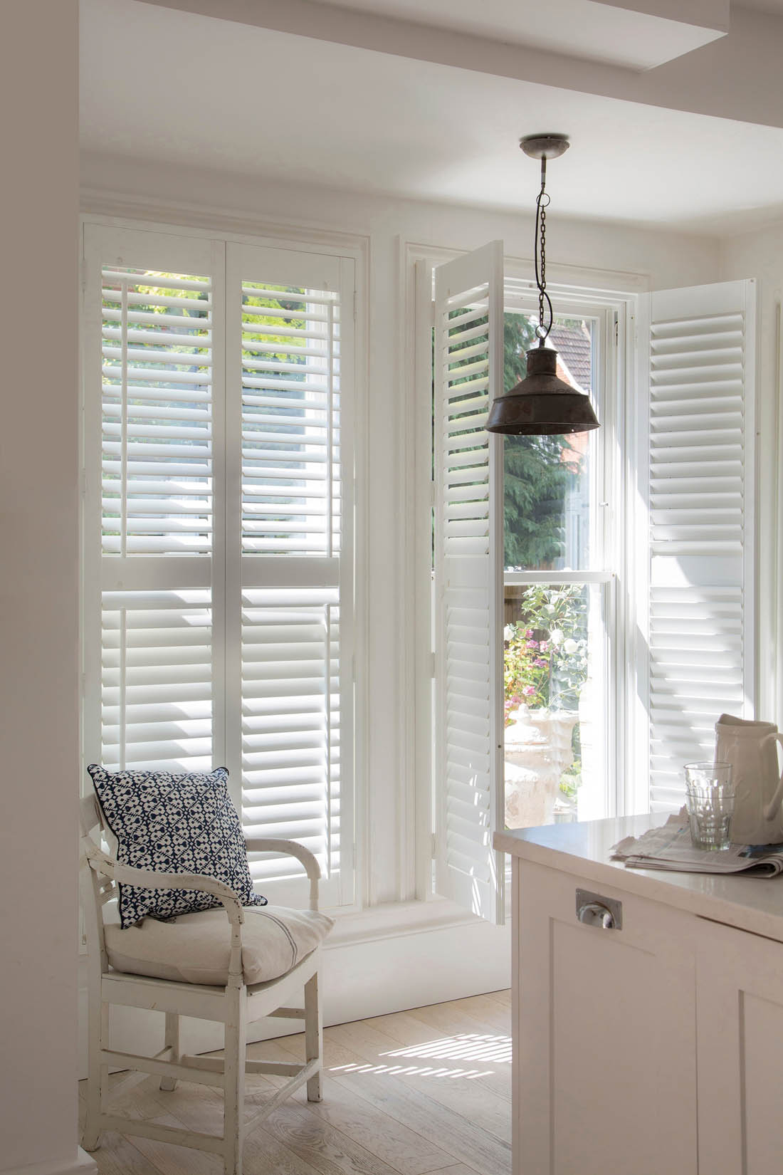 Full height interior wooden shutters in kitchen | Making the most of your windows | Luxaflex shutters | Apartment Apothecary
