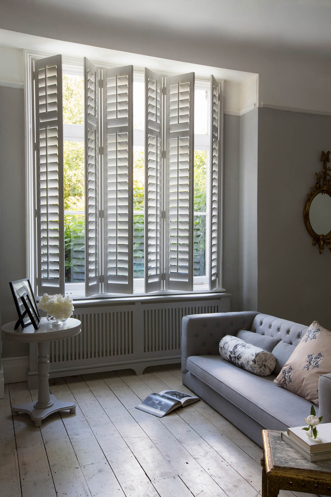 Full height interior wooden shutters in living room | Making the most of your windows | Luxaflex shutters | Apartment Apothecary