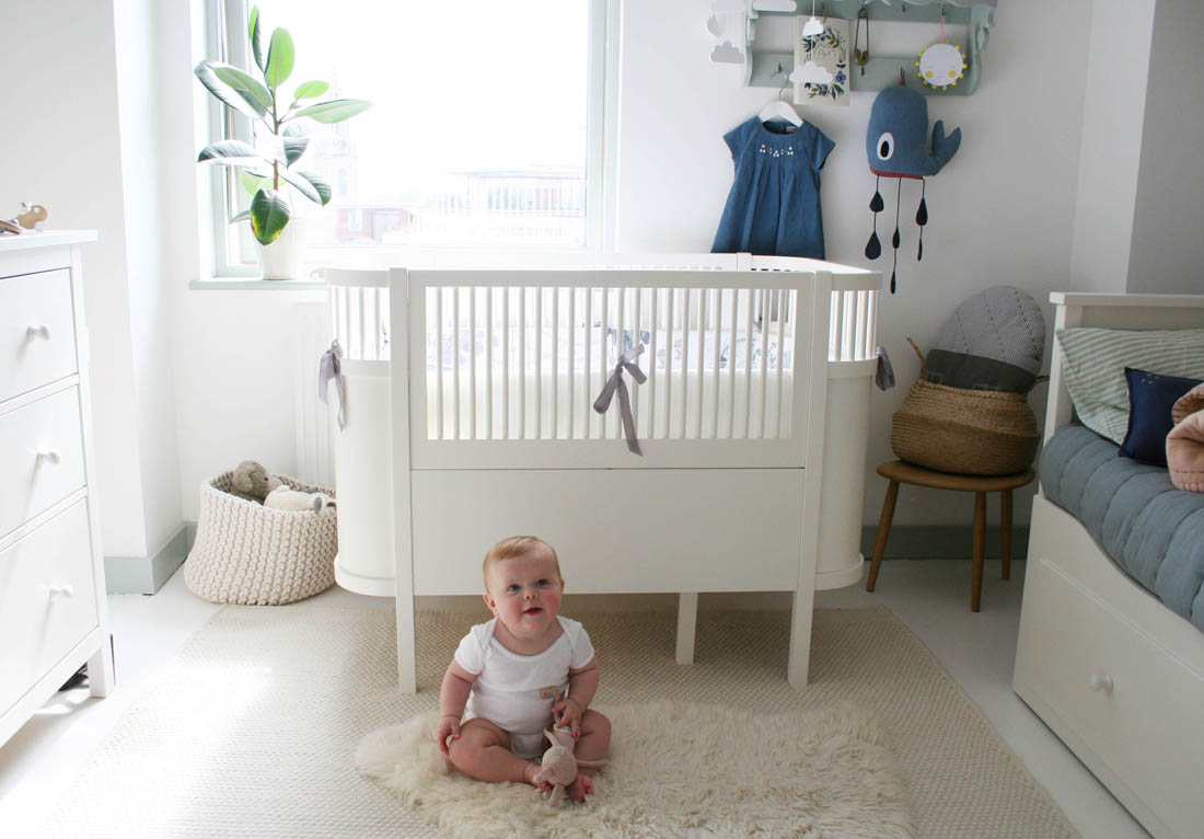 Gender neutral scandal style nursery decor inspiration with Sebra Kili cot bed with Garbo and Friends crib bumper