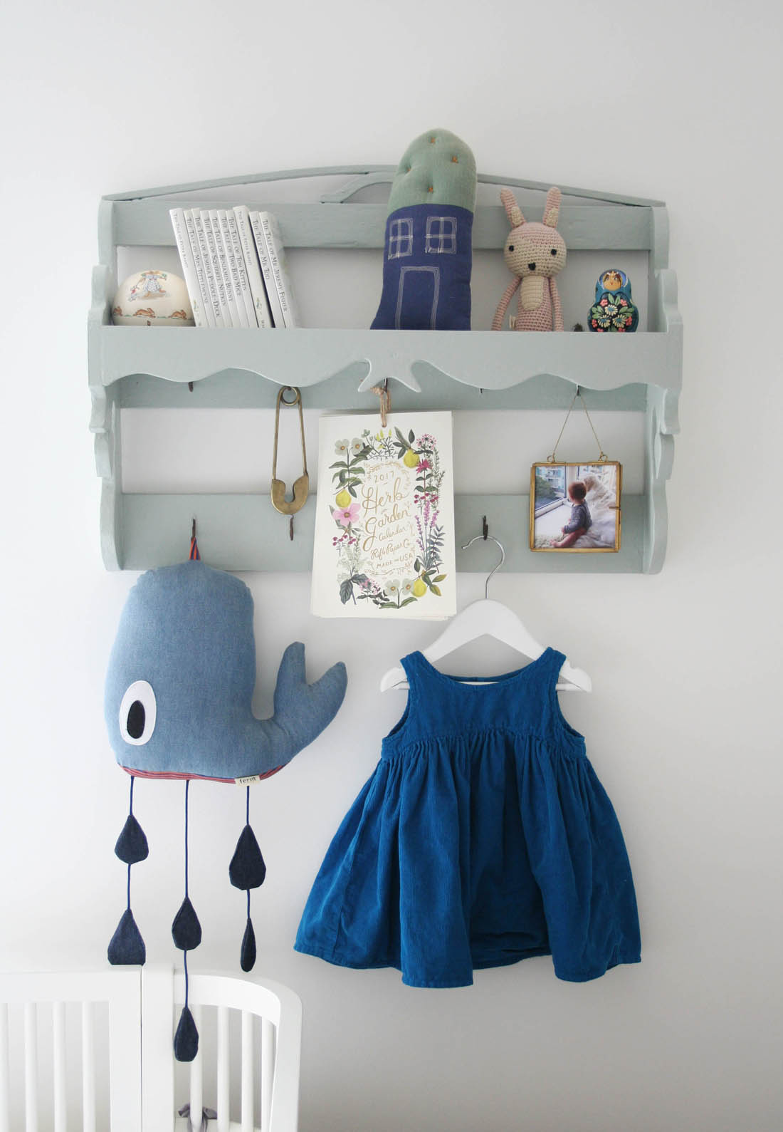 Hanging photo frame in Scandi inspired nursery with vintage shelves | Tesco Fox and Ivy collection